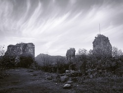 Monochrome image of phartskhisi fortress wall ruins close up. Giant wide archeological wall fortress ruins.