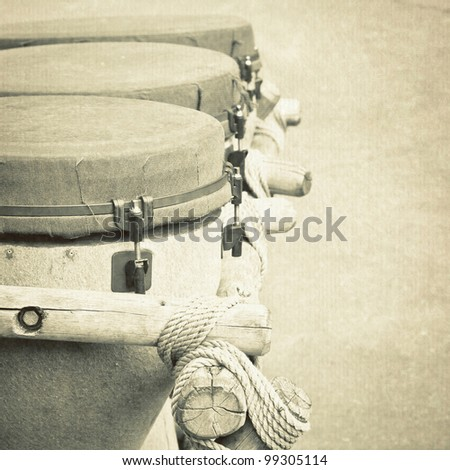Monochrome image of three old african bongo drums