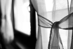Monochrome image, window curtain close up shot, shallow depth of field, copy space.