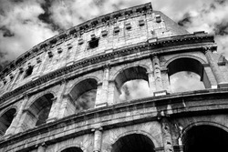 Monochrome photo of Colosseum - the most well-known and remarkable landmark of Rome and Italy