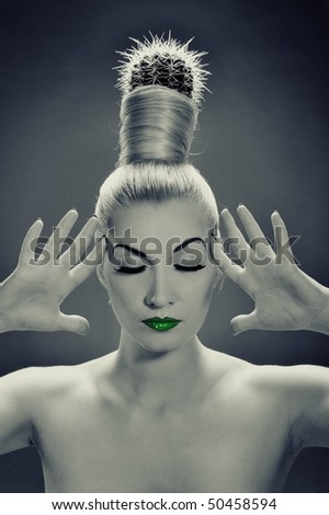 Monochrome picture of a woman with cactus in her hair