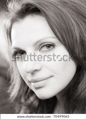 monochrome portrait of a charming young long-haired woman