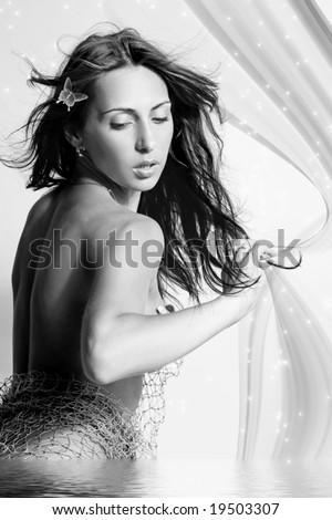 stock photo monochrome portrait of nude elegant woman in fishing seine 19503307 stock photo : Monochrome portrait of nude elegant woman in fishing seine