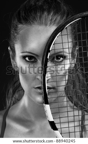 Monochrome portrait of young woman tennis player