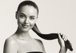 Monochrome woman beautiful portrait  long hair cosmetic concept beauty skin lips eyes young female model
