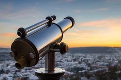 Monocular telescope at sunset over Marburg, Germany