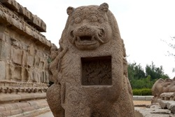 Monolithic stone carved lion sculpture in the complex of Shore temple at Mahabalipuram, Tamilnadu, India. Historical animal sculpture carvings in the heritage sites at India.