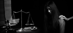Monotone of Sad Desperate woman try to support each other to understand feeling down who facing Legal Issue, Lawyer, Law Case or Court house.