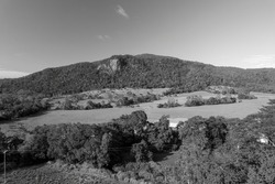 Monotone of the north face of Mount Blackwood at Mackay with a communications tower at its peak