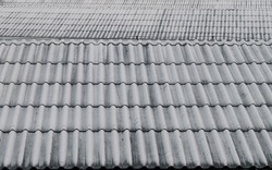 Monotone roof made of metal material as galvanized iron roof in Bangkok. Industrial exterior design as modern wallpaper. Durable roof view from next building. Strong construction on roof