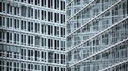 Monotonous facade of office tower with large window front in concrete construction