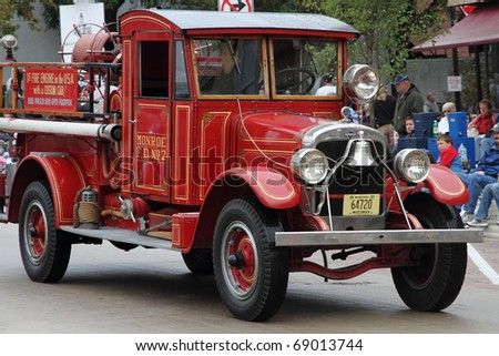 MONROE, WI - SEPTEMBER 19: Demonstration of a 1928 First Fire Engine with custom cab at the annual Cheese Festival and Parade on September 19, 2010 in Monroe, WI