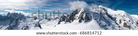 Mont Blanc is the highest mountain in the Alps and the highest in Europe. Beautiful panorama of European Alps in sunny day. Haute-Savoie, France #686814712