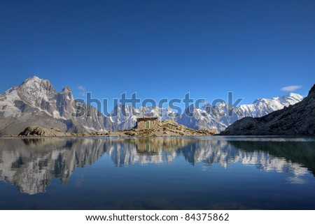 Mont Blanc Massif reflecting in Lake Blanc (Lac Blanc) above Chamonix, France.