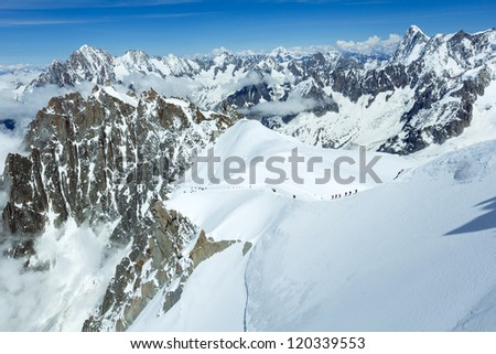 Mont Blanc mountain massif summer landscape with alpinists groups on slope (view from Aiguille du Midi Mount,  French, all peoples unrecognizable )