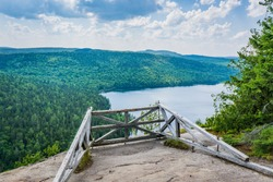 Mont Brassard hike in Parc Regional des 7 chutes in Quebec. This 8.5 kilometers hike offers great view of the typical nordic landscape. The sign says