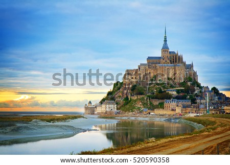 Mont St Michel city at sunset, Brittany France, toned