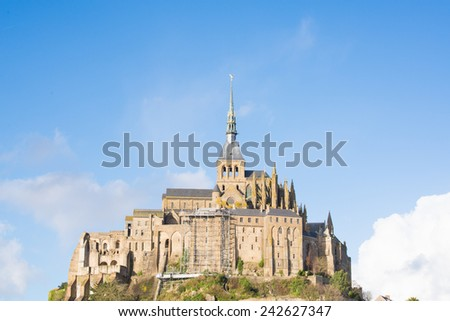 Mont St Michel touristic attraction of northern France in retro style - Famous historic place of French