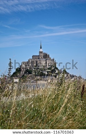 Mont St Michel world famous historic landmark in Normandy, France by the day - Hidden treasure tourist attraction in northern France - stock photo