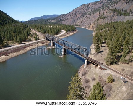 Montana mountain valley river, roads and trestle.