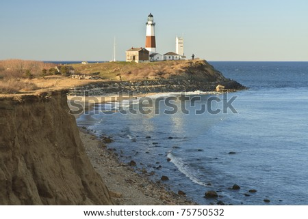 Montauk Lighthouse with an eroding bluff in the foreground on the Eastern tip of Long Island, NY
