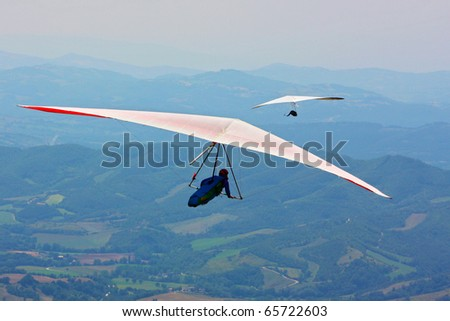 MONTE CUCCO, ITALY - AUGUST 12: Competitor of the Dutch Open-2010 hang gliding competitions takes part on the Monte Cucco mountain on August 12, 2010 near Cigillo, Italy.