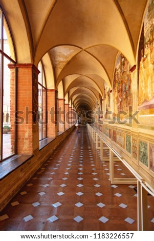 Monte Oliveto Maggiore, Siena, Tuscany -Italy, August 17, 2018: Corridor decorated with frescoes of Asciano Abbey #1183226557