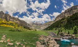 Monte Perdido and Ordesa valley with river and waterfall in the spanish national park Ordesa y Monte Perdido, Pyrenees, Spain