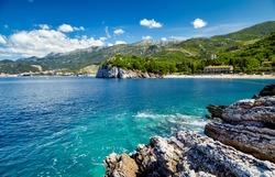 Montenegro beach beautiful Adriatic sea blue water coast bay shore nature summer resort tourism vacation landmark and clouds in the sky panorama view. Europe, Mediterranean