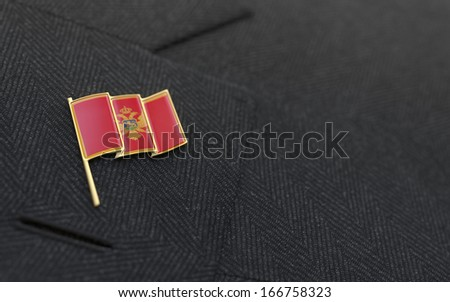 Montenegro flag lapel pin on the collar of a business suit jacket shows patriotism