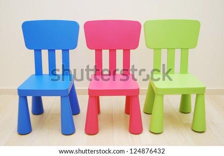 Montessori Kindergarten Preschool Classroom with table and three chairs