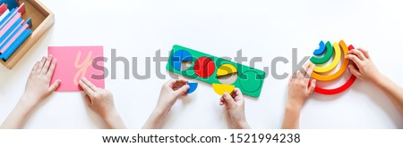 Montessori material. Children's hands. The study of mathematics and biology. School and kindergarten. Benner