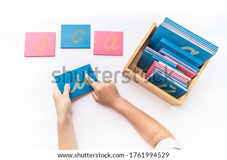 Montessori material letter flat lay. Children's hands. English alphabet ストックフォト ©