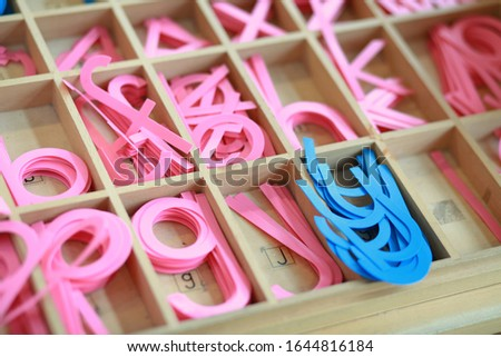 Photo of  Montessori material writing letters movable alphabet