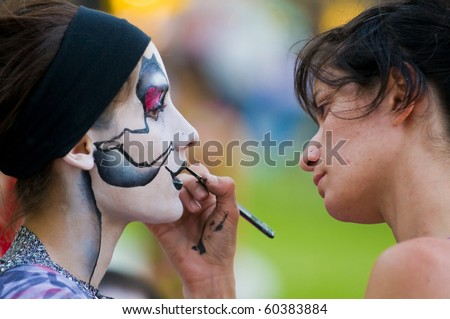 MONTEVIDEO, URUGUAY - JANUARY 28 : A carnaval participant has his face covered with makeup on  January 28 2010  in Montevideo Uruguay this is  the annual national festival of Uruguay - stock photo