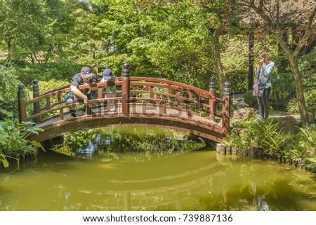 MONTEVIDEO, URUGUAY, MARCH - 2016 - Family enjoying a sunny day at botanical garden of Montevideo