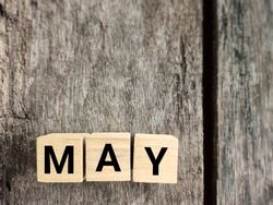 Month of May text with vintage background. Stock photo.