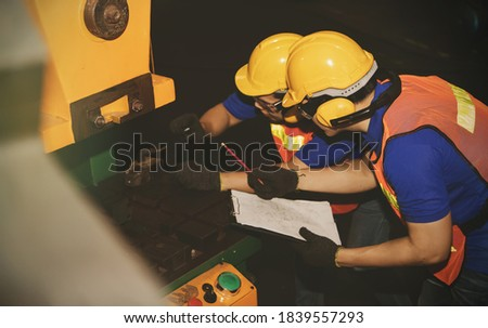 Monthly inspection of safety equipment : Engineering workers, engineers, technicians work as a team work, inspecting the use of hydraulic machinery in industrial plants for safety and efficiency. Photo stock ©