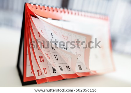 Months and dates shown on a calendar whilst turning the pages #502856116