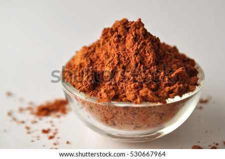 Montmorillonite red clay powder in a glass bowl isolated #530667964