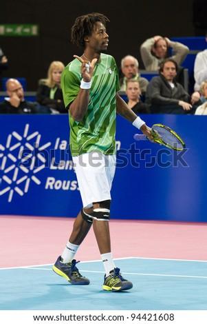 MONTPELLIER, FRANCE - FEBRUARY 4: Gaël Sébastien Monfils (FRA) defeats Gille Simon (FRA) at the ATP Sud de France Tennis Open February 4, 2012 in Montpellier, FRANCE.