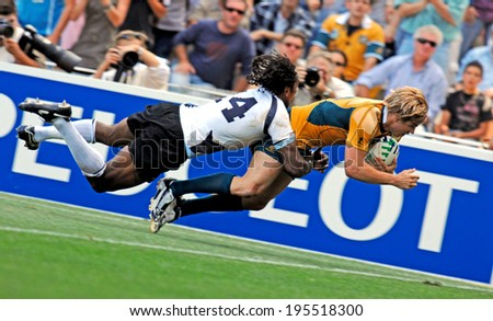 MONTPELLIER, FRANCE-SEPTEMBER 23, 2007: australian rugby player, Drew Mitchell, scores a try during the match Australia vs Fiji, at the Rugby World Cup, France 2007, in Montpellier.