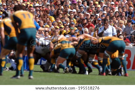 MONTPELLIER, FRANCE-SEPTEMBER 23, 2007: australian rugby players scrum during the match Australia vs Fiji, at the Rugby World Cup, France 2007, in Montpellier.