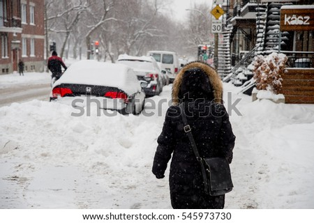 Montreal, CA - 12 December 2016: Snowstorm in Montreal. Pedestrians in Plateau Neighbourhood #545973730