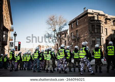 MONTREAL, CANADA   APRIL 02 2015: Riot in the Montreal Streets to counter the Economic Austerity Measures. Cops making a line to Control the Protesters