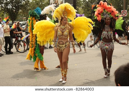 MONTREAL, CANADA - AUGUST 14: Participating dancers in colorful costumes at the Montreal Annual Gay Pride parade August 14, 2011, Montreal. - stock photo