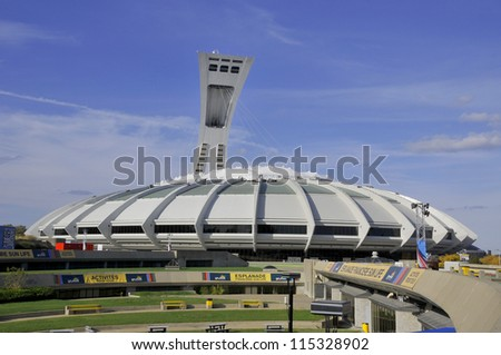MONTREAL,CANADA -AUGUST 8. The Montreal Olympic Stadium and tower on August, 08 , 2012. It's the tallest inclined tower in the world.Tour Olympique stands 175 meters tall and at a 45-degree angle