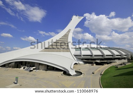 MONTREAL,CANADA -AUGUST 12. The Montreal Olympic Stadium tower on August, 08 , 2012. It's the tallest inclined tower in the world.Tour Olympique stands 175 meters tall and at a 45-degree angle