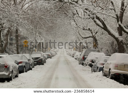 MONTREAL, CANADA, DECEMBER 10, 2014:  First snowstorm of 2014-2015 winter season in Montreal, Quebec.  More than 30 cm in 1 day on the city. #236858614