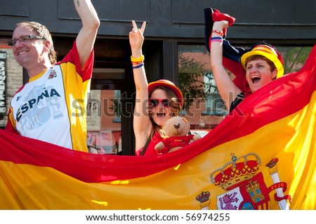 MONTREAL, CANADA - JULY 11: Celebrations in the streets of Montreal after Spain's victory at the FIFA World Cup.  July 11, 2010.  Montreal, Canada